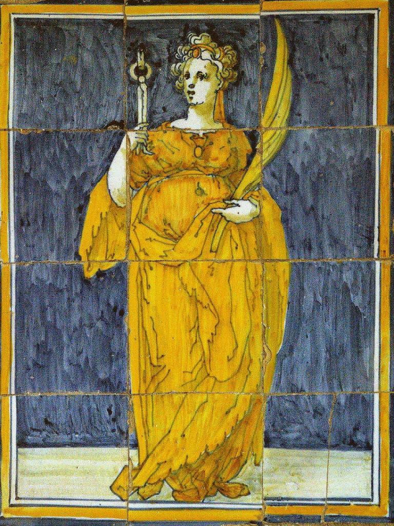 Ermita de la Virgen de Gracia de Velada. Retablo lateral. Siglo XVII. Policromía con predominio de naranjas, amarillos y azules. Las figuras son esbeltas y el dibujo aunque muy rectilíneo, es seguro y de calidad, por lo que algunos han querido identificar a su autor con algún pintor del taller de El Greco. El retablo enmarca las figuras entre columnas, mármoles simulados y cenefas de hojas de acanto y cadeneta. La santa sostiene la palma del martirio y una muela con las tenazas.