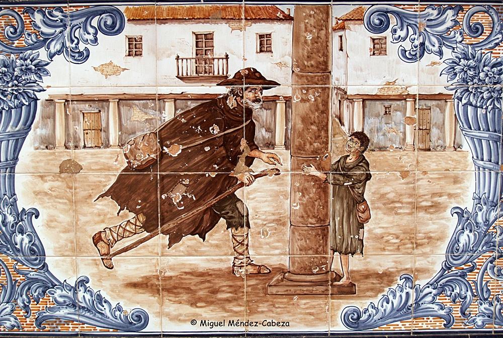 Panel de azulejos en la plaza de Escalona que representa la venganza de Lazarillo con el ciego